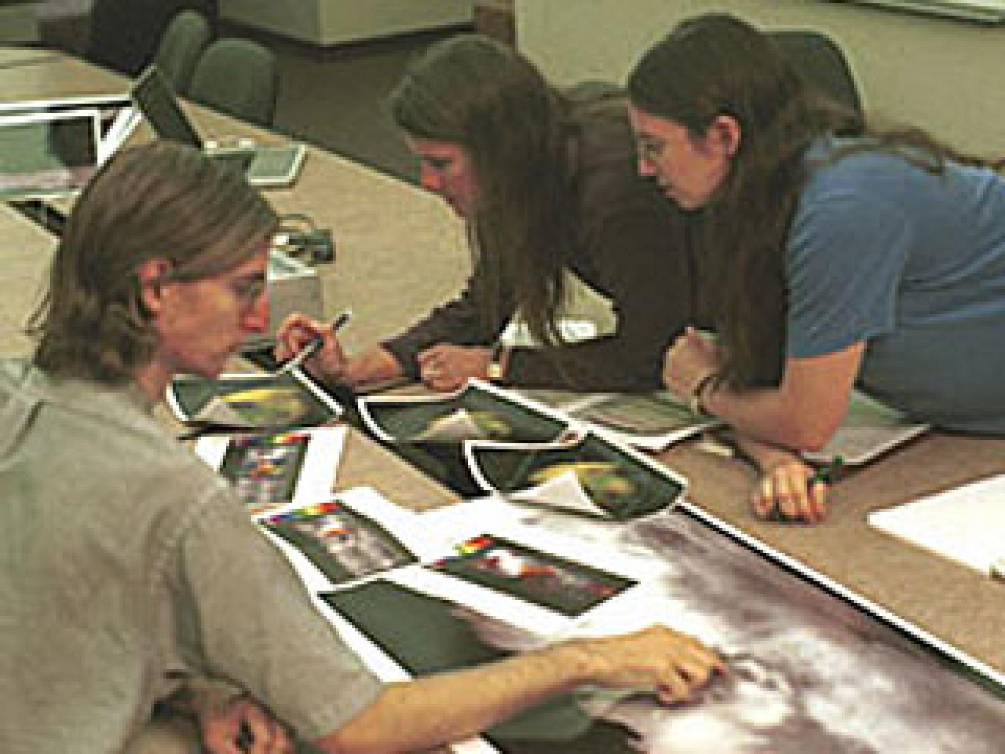 Jason Perry, Elizabeth Turtle and Stephanie Campbell plan imaging sequences for the first close Titan flyby.