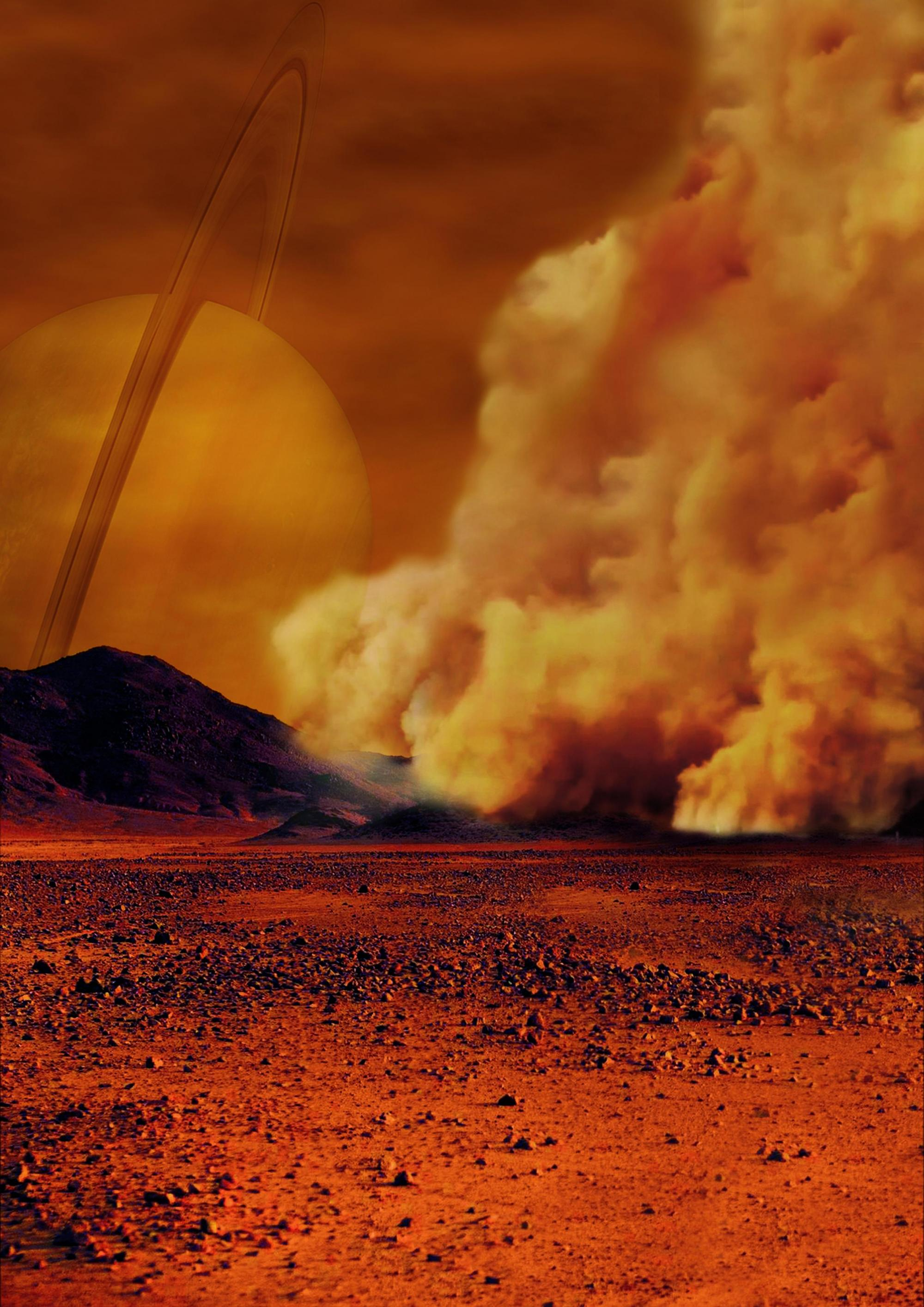 An artist's concept of a dust storm on Titan. Researchers believe that huge amounts of dust can be raised on Titan, Saturn's largest moon, by strong wind gusts that arise in powerful methane storms.