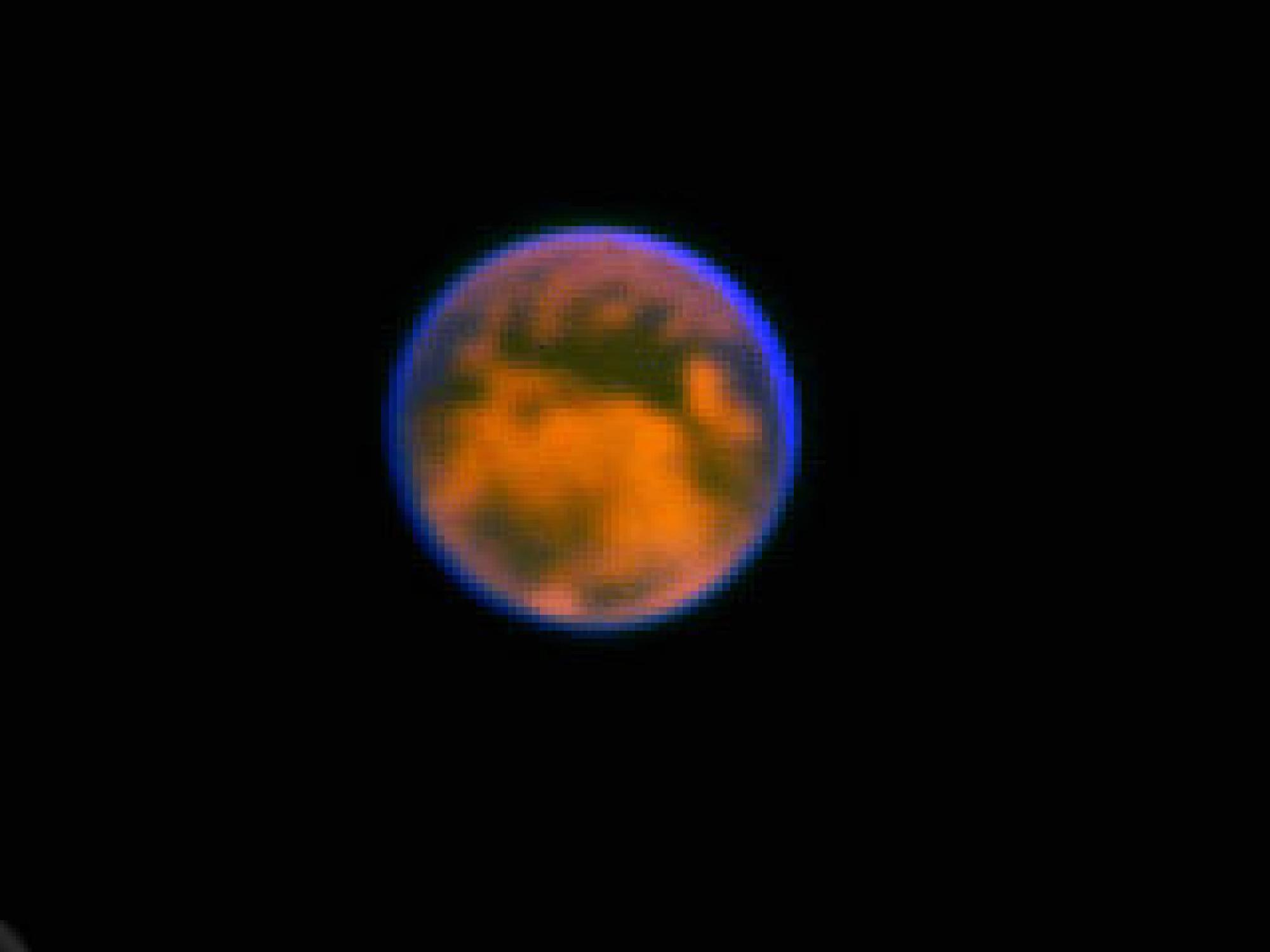 This extraordinary view of  Saturn's moon, Titan, was produced with an Earth-based telescope using a new kind of camera developed by UA astronomer Laird Close. Titan is about 800 million miles away. The resolution of this image is 360 kilometers, abo