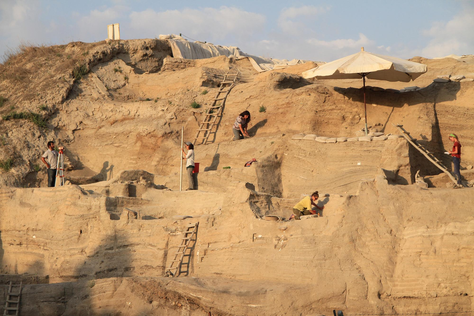 Researchers working on the western Section of the archeological dig at Aşıklı Höyük, Turkey. Scientists analyzed urine salts from this site to figure out when the people first began to keep sheep and goats.