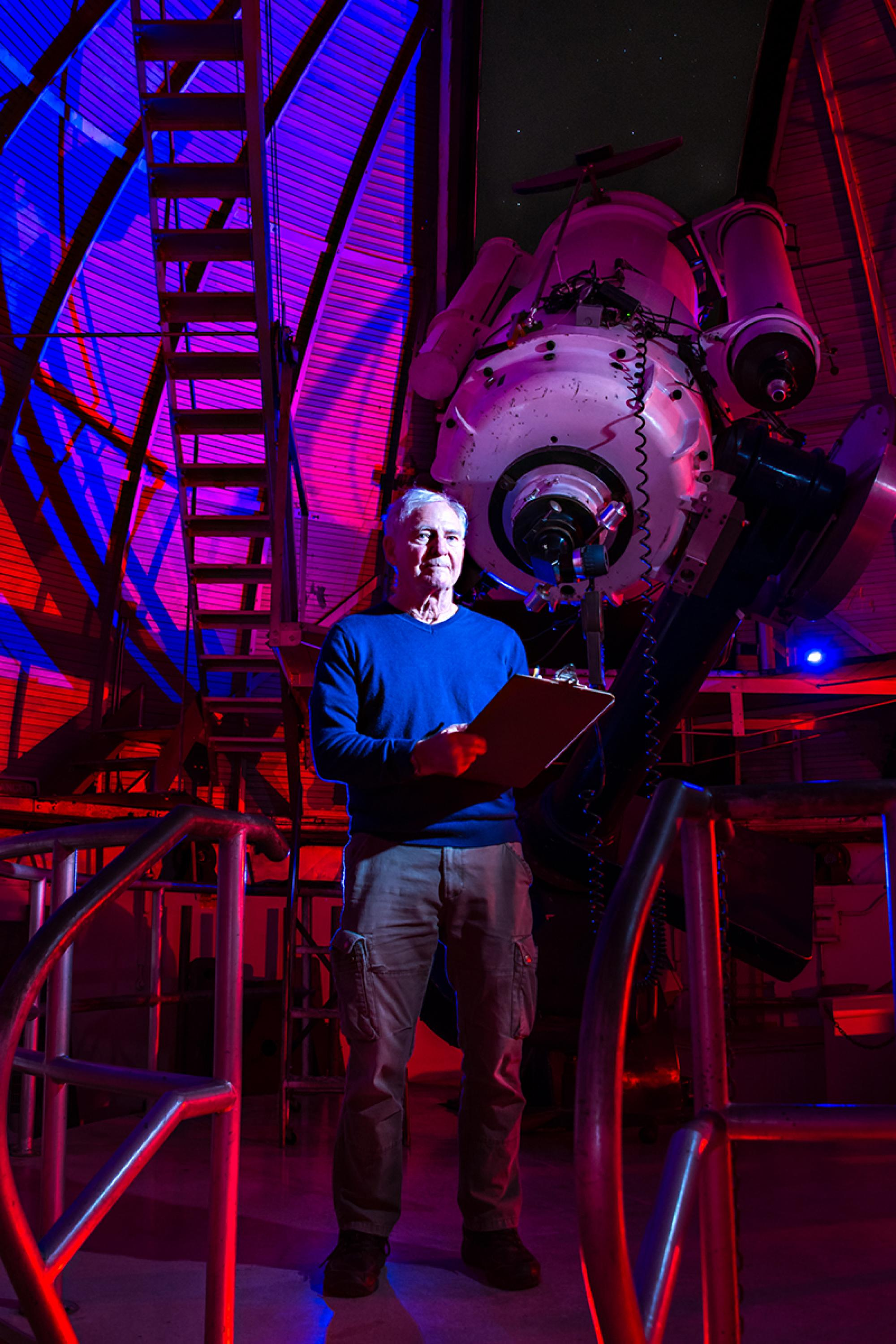 John Cocke next to the 21-inch telescope at Steward Observatory on the UA campus.