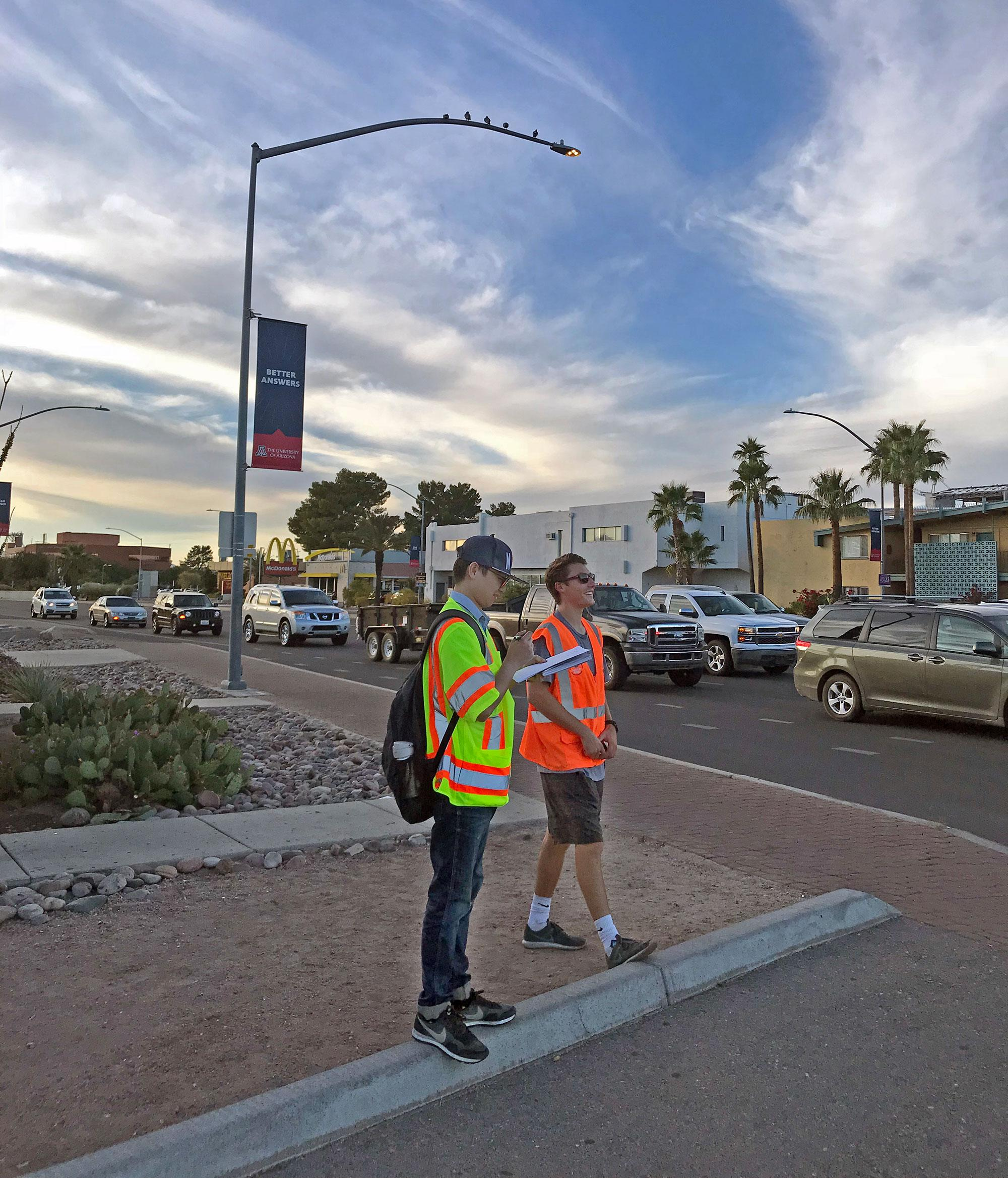 Xiaofeng Li, a graduate research assistant in Wu's lab, and Alex Weber, who earned his Masters of Engineering from UArizona in 2018, conduct research on Speedway Boulevard.