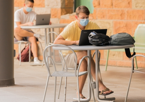 student in face covering on campus