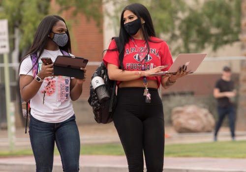 students in face coverings on campus