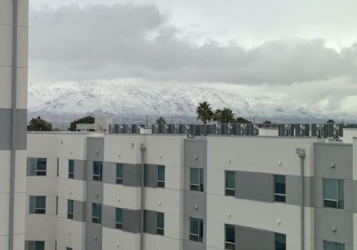 gray sky behind a gray building