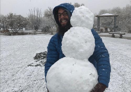 man holding a snowman