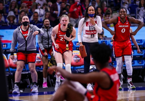 basketball players cheering