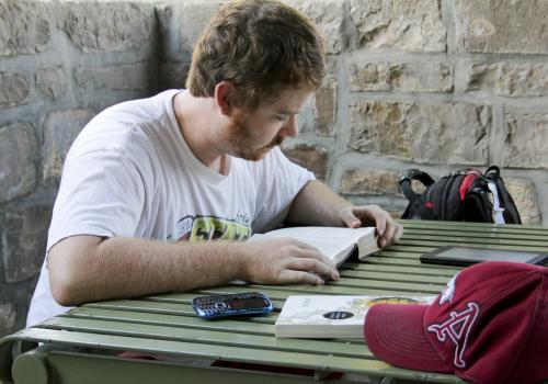 """Sept. 4, 5:14 p.m.: Kyle Germany, a religious studies senior, spends the afternoon reading from a Bible. """"I come every day for several hours. It's a very peaceful place, and the renovations are amazing. It's a big improvement."""""""