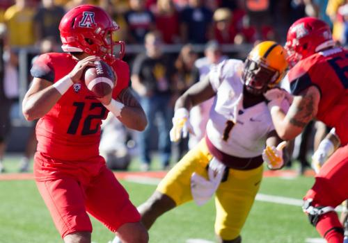 """Anu  toughed it out. He was gutty, made a couple big throws. Anu's a competitor and he's a great leader for being a young redshirt freshman,"" said head coach Rich Rodriguez."