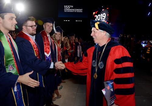 Dr. Robert C. Robbins greets UA graduates.