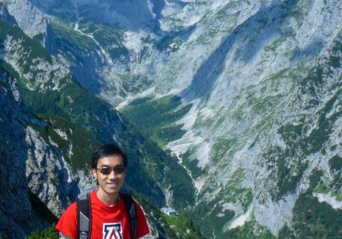 Alumnus Patt Intarakamhang, who earned a degree in mechanical engineering and was an honors student, shows his Wildcat pride atop a mountain in southern Germany.