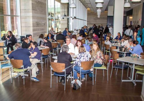 Banner – University Medical Center Tucson employees dine at the hospital's new cafeteria at an April 7 employee celebration of the tower's opening.