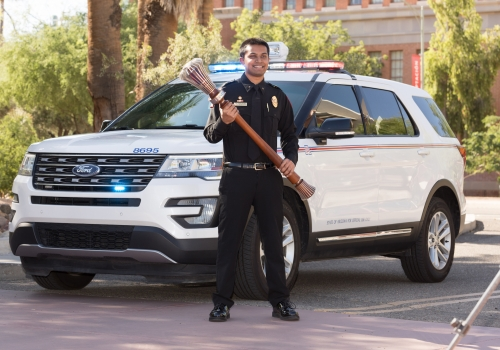 Abhijay Murugesan, a senior graduating with a degree in public health and the chief and executive director of the university's student Emergency Medical Service team, poses with the university's ceremonial mace during filming for the virtual 2020 Commence