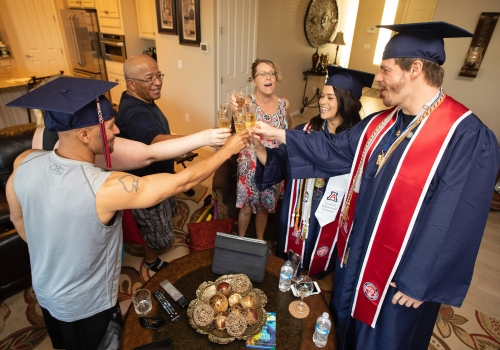 Lauren Easter , this year's Provost Award winner, celebrates with her partner and fellow graduate Zachary Stout  and family and friends.