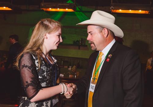4-H member Lindy Hauser met Arizona Senator David Gowan at the Clover Ball.