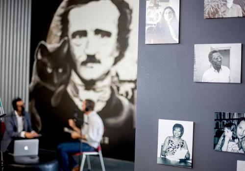 """The Poetry Center offers exhibitions of art and library selections, which are mounted throughout the year. The center also hosts work by Tucson artists as well as traveling exhibits. One of its permanent exhibitions is the """"Wall of Poets"""" highlighting tho"""