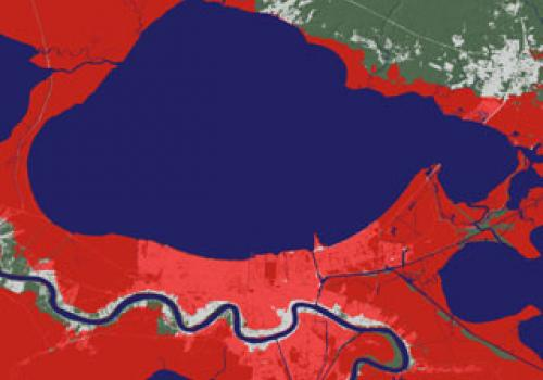 An image of the area around New Orleans, La., with the water shown in blue. The portions of the image colored pink and red represent areas that would be submerged if sea level rose about three feet . Courtesy of Jeremy Weiss and Jonathan Overpeck, The Uni