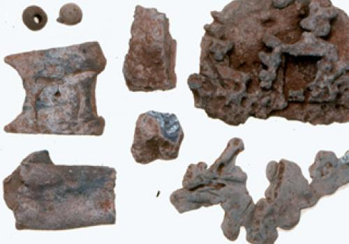 Samples of galena, a silver-bearing lead ore, and worked pieces of lead recovered from the archaeological dig at La Isabela.   Photos: Copyright 1998. James Quine, Florida Museum of Natural History, University of Florida.
