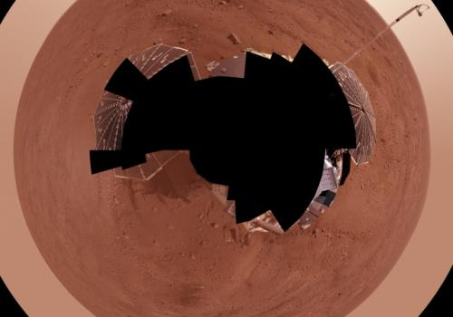 This view combines more than 400 images taken during the first several weeks after NASA's Phoenix Mars Lander arrived on an arctic plain at 62.22 degrees north latitude, 234.25 degrees east longitude on Mars. The full-circle panorama in approximately true