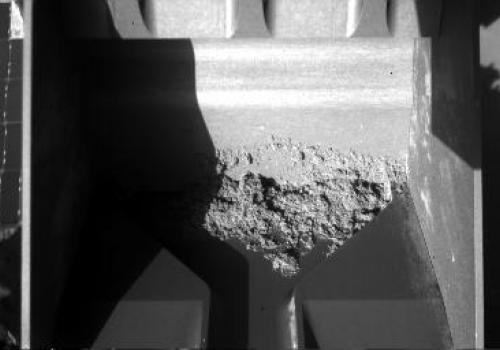 NASA's Phoenix Mars Lander started its 62nd Martian day, or sol,  with an empty scoop, then collected material expected to be icy soil and attempted to deliver some of the sample to a laboratory oven on the deck. This image taken after the scoop had been
