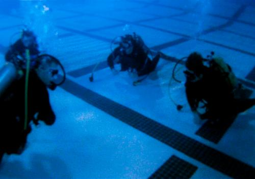 Students learn to breathe comfortably underwater in the deep end of the Rec Center pool.