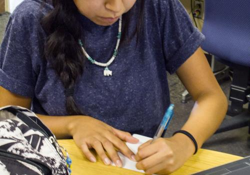 Kierstyn Tsosie, a student in the UA School of Government and Public Policy, takes time to study at the Native American Student Affairs study lounge, a regular meeting space for students.