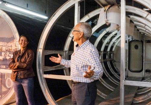 Erica Hernandez and Gene Giacomelli speak about the Prototype Lunar Greenhouse Lab. For her academic and professional success, Hernandez also credits Giacomelli, Susan Brew of the Arizona Space Grant Consortium, Andrew Huerta of the Graduate College and R