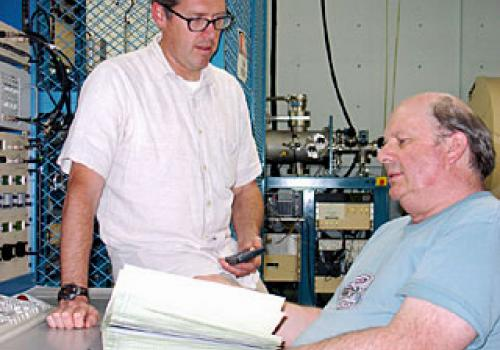 Gregory Hodgins , assistant research scientist, and  A. J. Tim Jull, director of the National Science Foundation-Arizona AMS Laboratory, discuss radiocarbon age results. The laboratory is jointly operated by the physics and geosciences departments at The