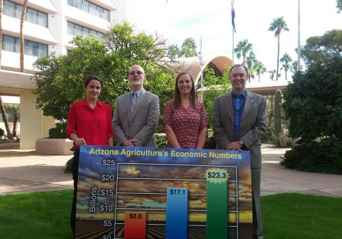 The Economic Impact Analysis Team, from left: Dari Duval, George Frisvold and Ashley Kerna, with College of Agriculture and Life Sciences Dean Shane Burgess