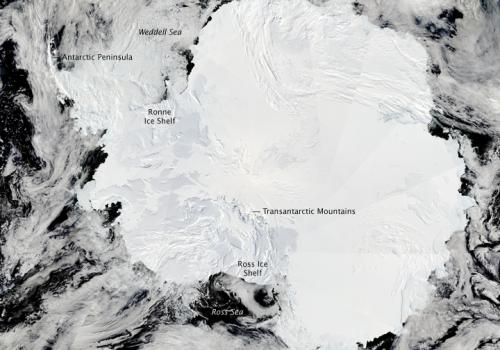 """The Moderate Resolution Imaging Spectroradiometer on NASA's Aqua satellite captured this composite image of Antarctica's ice-covered landscape on Jan. 27, 2009. The surface appears rough where the Transantarctic Mountains curve in a shallow """"s"""" from the s"""