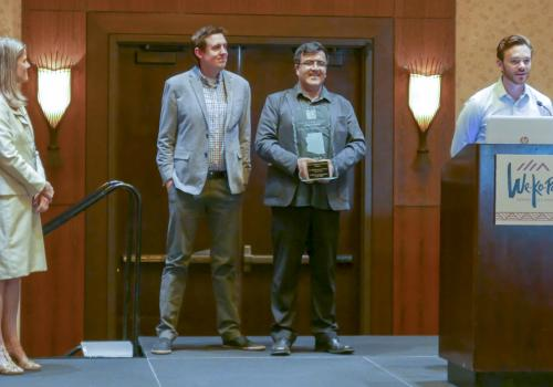 Chris Ortiz y Pino, who recently graduated from the UA with a master's degree in planning, accepts the 2017 Best Student Planning Project Award from the Arizona Chapter of the American Planning Association while UA faculty members Kelly Cederberg, Arlie A