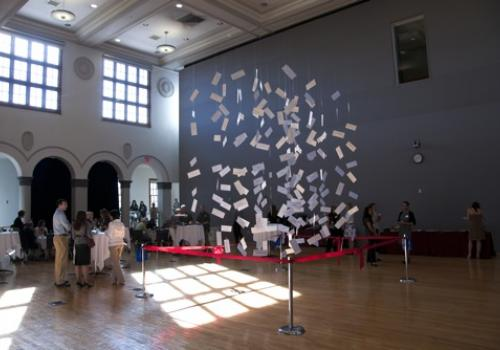 """Twenty-four match envelopes were among those dangled in a """"cloud sculpture"""" in the Virginia G. Piper Auditorium at the College of Medicine–Phoenix."""