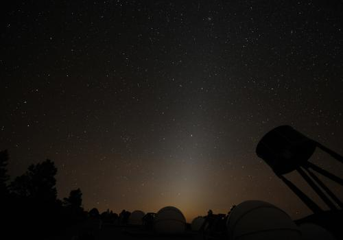 Sometimes mistaken for light pollution, zodiacal light is sunlight that is reflected by zodiacal dust. It is most visible several hours after sunset on dark, cloudless nights surrounding the spring and fall equinoxes, when the Earth's equator is aligned w