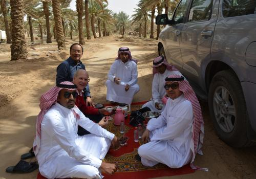 Kevin Fitzsimmons and Joel Cuello  and Khalid Assiry , together with staff, interview a farmer  in Ha'il, Saudi Arabia.