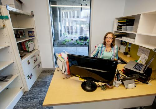 Angie Brown, the Institute of the Environment's projects and events coordinator, gets acclimated to her new space. Brown also is a member of the Art & Environment Network, an on- and off-campus group of individuals working to create more cohesion between