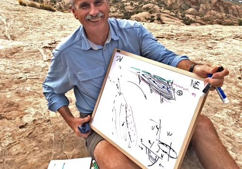 Paleofluids collaborator and structural geologist Bob Krantz reviews Paradox Basin tectonic history overlooking the Moab Fault.
