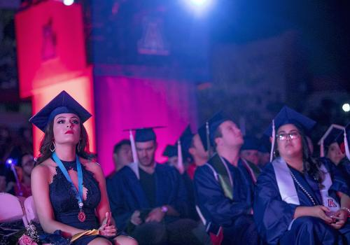 Paris Prynkiewicz, a psychology honors student from Phoenix, listens to the speakers at Commencement.