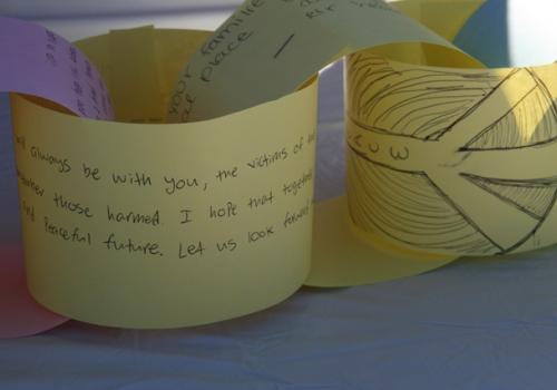 """UA student volunteers invited people to write messages on a """"Chain of Expression."""""""