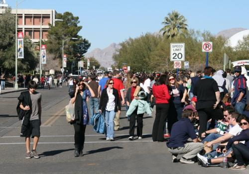 """Tens of thousands of people converged at the UA to attend """"Together We Thrive: Tucson and America,"""" the Wednesday night event during which Obama spoke."""