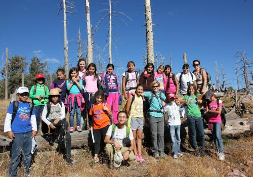 Pacifica Sommers  created a curriculum of activities and games to allow the students to explore the environment on Mt. Lemmon. For many trip participants, this was the first time they had journeyed outside of the city streets. (Photo by Alan Strauss