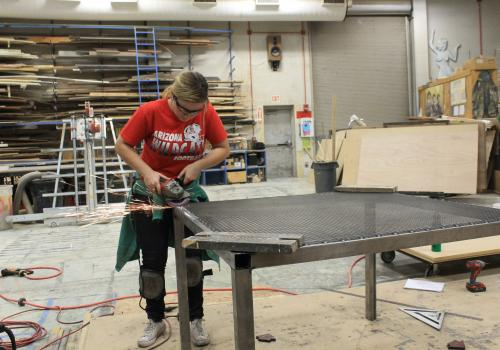 With financial support from the UA Green Fund, Inga Kalvaitis, a theater production major in the UA School of Theatre, Film and Television, designed and built sorting tables for volunteers to use after the Homecoming game. The tables are meant to make the