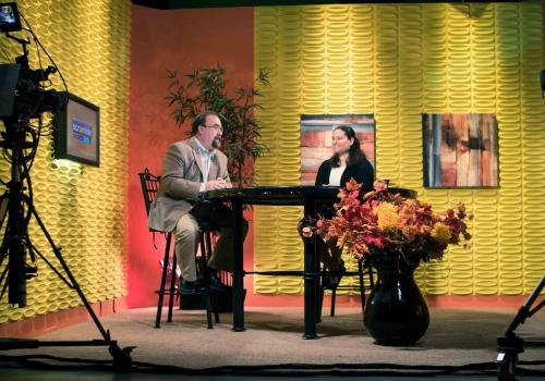 """Natalie Lucas, who has organized a diverse group of undergraduate and graduate students to attend COP21, discusses her """"Roadtrip to Paris"""" during an interview on """"The Morning Scramble"""" in Prescott, Arizona."""