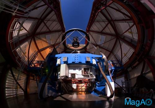 The Magellan Telescope with the MagAO's Adaptive Secondary Mirror mounted at the top looking down some 30 feet onto the 21-foot diameter primary mirror, which is encased inside the blue mirror cell.