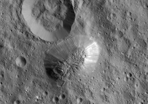 Ceres' mysterious mountain Ahuna Mons is seen in this mosaic of images from NASA's Dawn spacecraft. Dawn took these images from 240 miles  above the surface, in December 2015. The resolution of the image is 120 feet  per pixel.