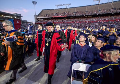 President Robert C. Robbins enters for his first UA Commencement at Arizona Stadium.