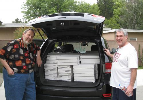 Rock Currier  and Robert Downs stand by Downs' rental car before his drive back to Tucson with the second load of the donated mineral collection. Half of the specimens were shipped, but the more delicate ones were packed and driven from LA.