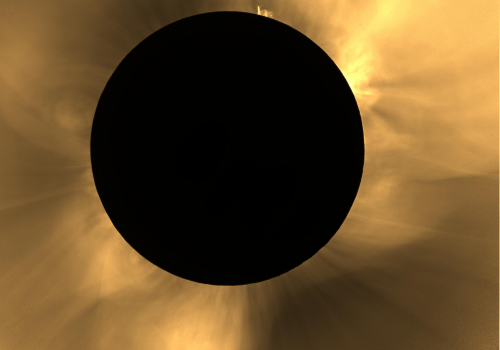 """Adriana Mitchell explains what we see in this image of the 2016 total solar eclipse in Indonesia: """"We applied filters so you can better see the coronal features. Polar plumes — the long thin streamers emerging from the sun's north and south poles — can be"""
