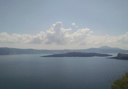 A view across the Santorini caldera from the island of Therasia. The entire calderas is approximately 6 miles in diameter and the islands visible in the center are where the currently active vents are located.