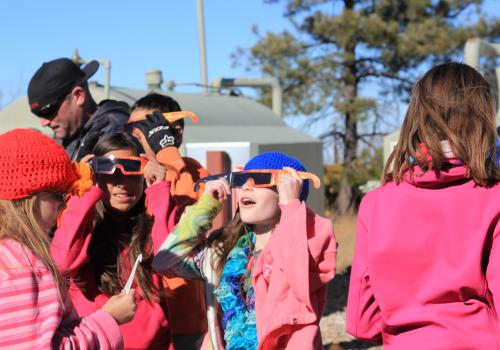 Students don protective glasses to look at the sun at the summit of Mt. Lemmon, just over 9,000 feet.