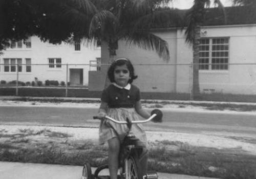 Bess de Farber's father took this picture of her in 1962 in front of Coral Way Elementary School, the year before the historic program was introduced.